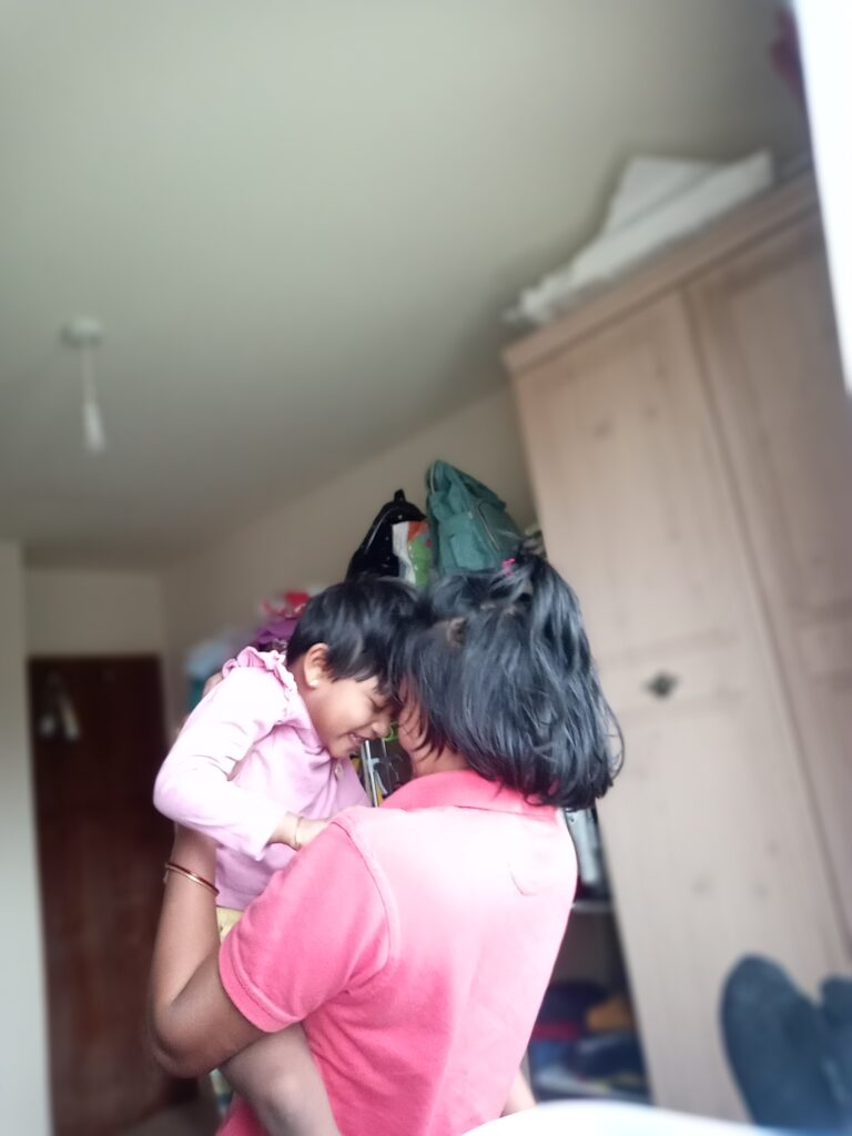 Mother holding her daughter and cherishing a cute moment together as she turns 4 in a month for One Happy Amma.